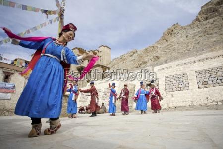 men and women dancing in square