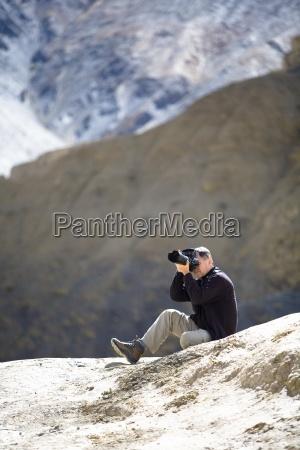 man taking photo ladakh kashmir india