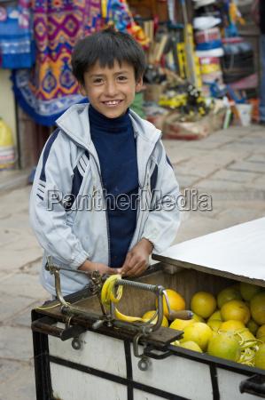 a boy smiles as he tends