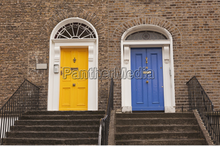 a yellow door and a blue
