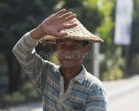 a man wearing a conical hat