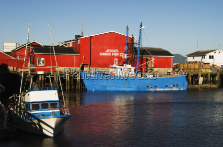 bright red building and blue boat