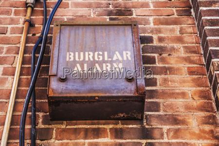 burglar alarm on the side of