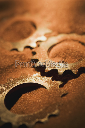 gears covered in sand