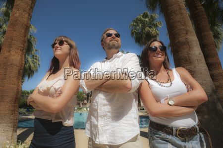two young women and a man
