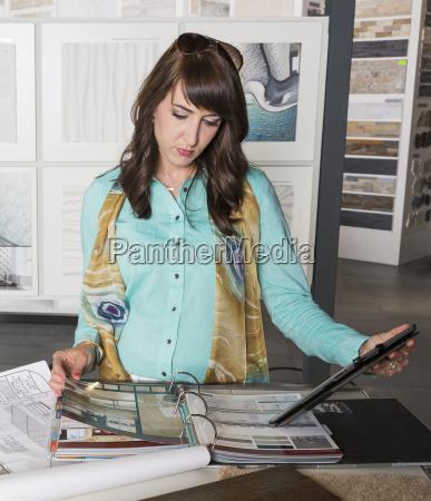 interior designer selecting tiles in showroom