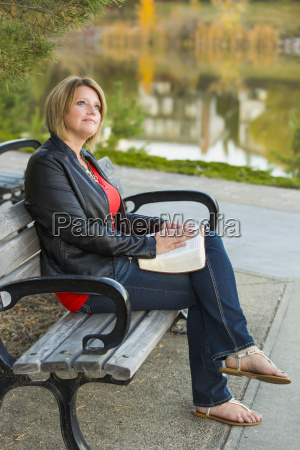 mature christian woman studying her bible