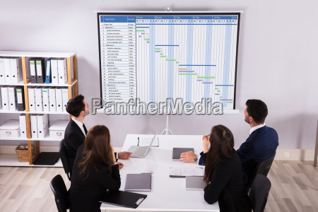 businesspeople analyzing gantt chart