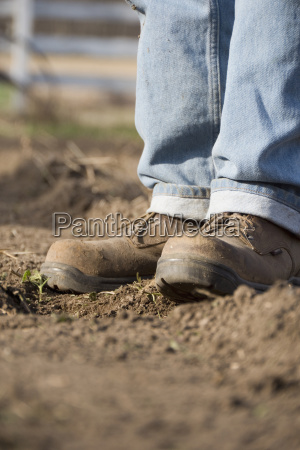 farmers boots standing in a freshly