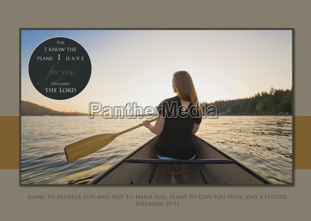 a young woman rowing in a