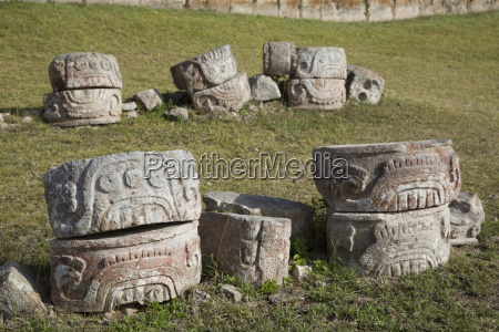 stone glyphs in front of the