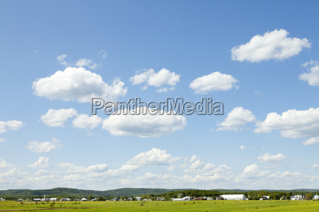 cultivated field farm in background quebec