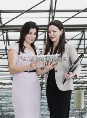two professional business women using a