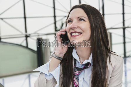 mature business woman talking on her