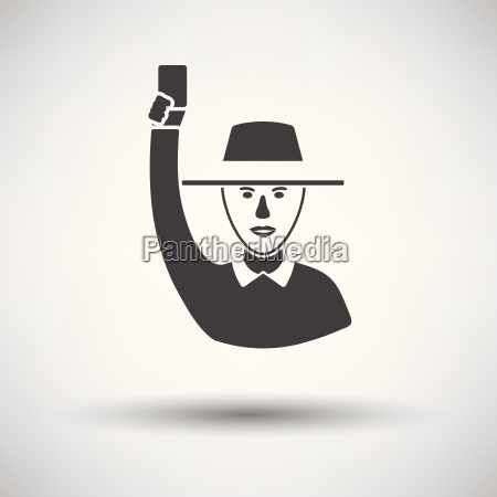 cricket umpire with hand holding card