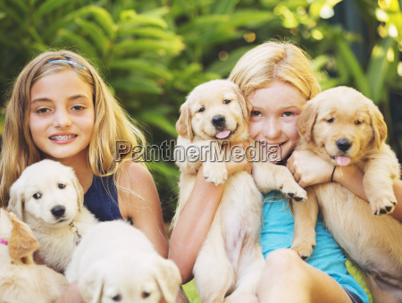 adorable cute young girls with puppies