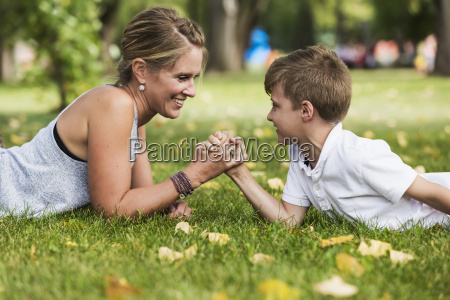 mother arm wrestling with her son
