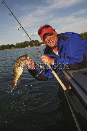 walleye fisherman lipping walleye
