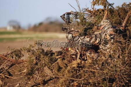 turkey hunter sits in ground blind