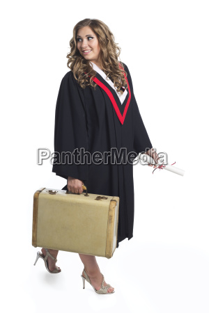 young graduating woman holding luggage symbolizing