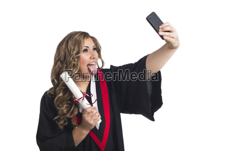 young graduating woman taking a self