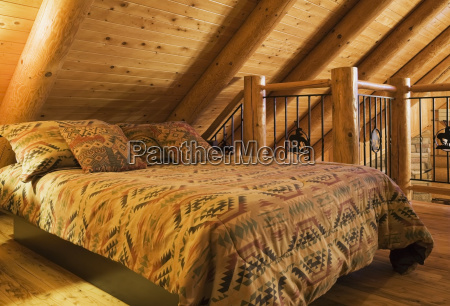 queen size bed with navajo patterned