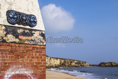 abandoned brick shelter on a beach