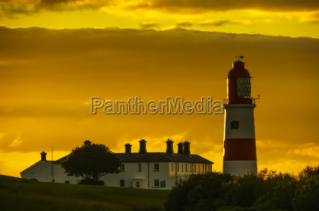 souter lighthouse under a glowing golden
