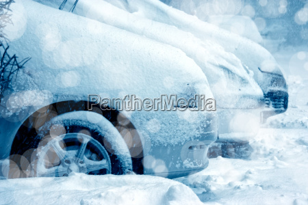 snow covered parked cars