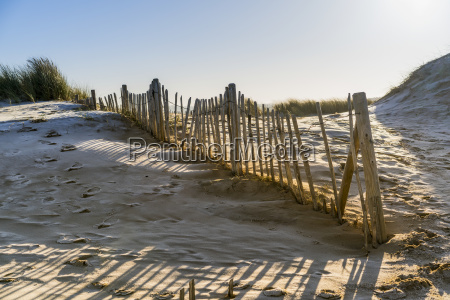 a wooden picket fence along a