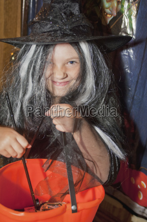 a girl in a witch costume