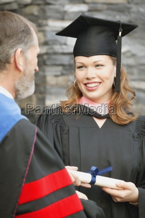 a woman receives her diploma