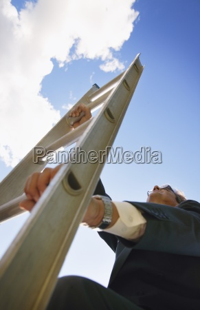 a businessman climbing the corporate ladder