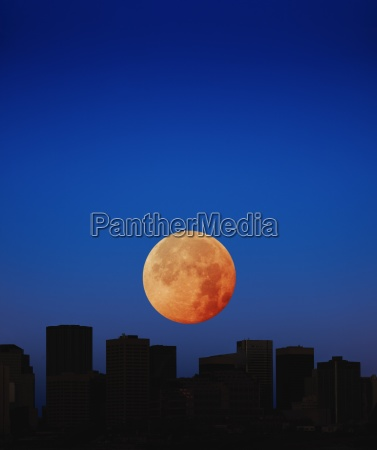 orange moon in dark sky