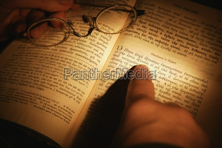open bible and pair of spectacles