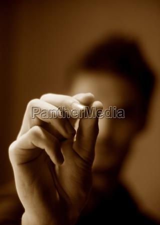 man pinching air