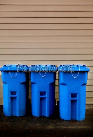 row of recycle bins