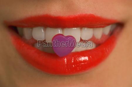 heart candy stuck on teeth