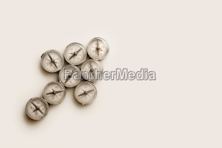 eight small compasses