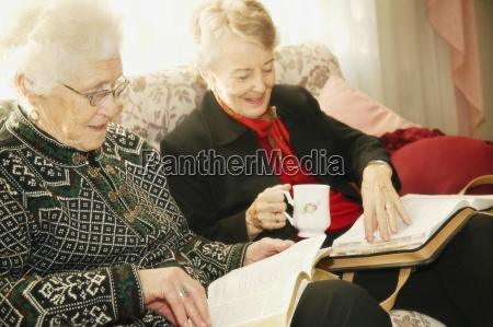 two older women reading bible