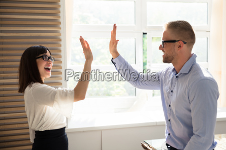 businessman giving high five to his