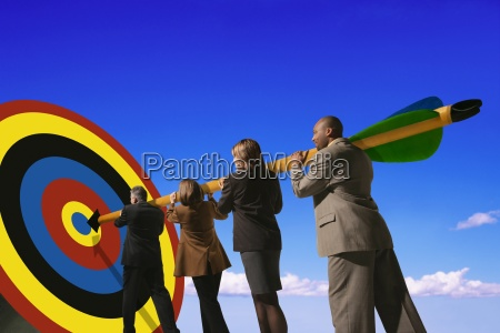 business people putting arrow on target