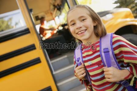 child ready to board school bus