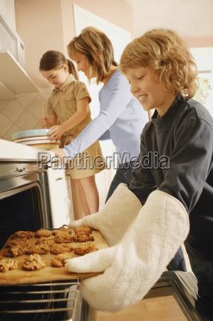 children helping to bake cookies