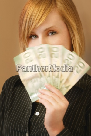 woman holding canadian twenty dollar bills