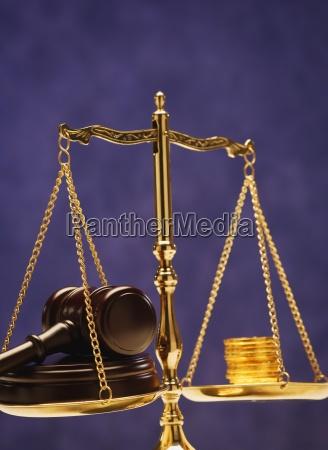 balancing money and justice
