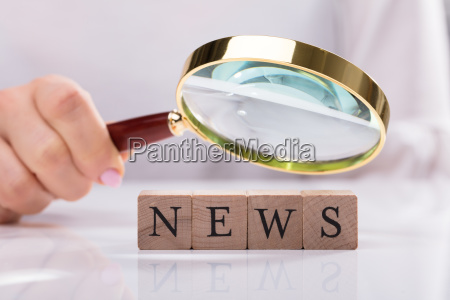 businesswoman examining news cubic blocks