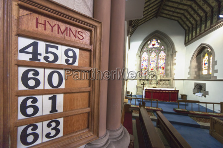 hymn numbers posted on a wooden