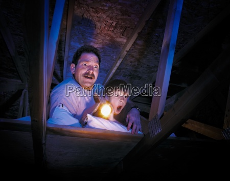 dad and child in the attic
