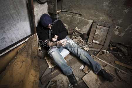 man injecting drugs